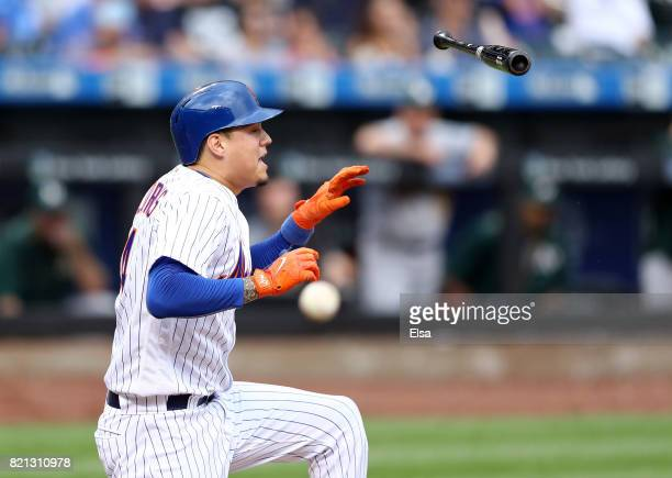 Wilmer Flores of the New York Mets loses his bat on a foul tip in the ninth inning against the Oakland Athletics on July 23 2017 at Citi Field in the...
