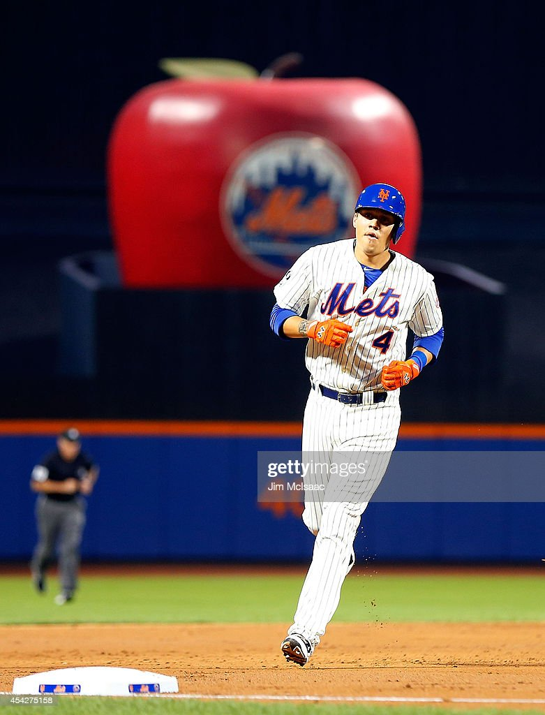 Wilmer Flores #4 of the New York Mets runs the bases after his second inning home run against the Atlanta Braves at Citi Field on August 27, 2014 in the Flushing neighborhood of the Queens borough of New York City.