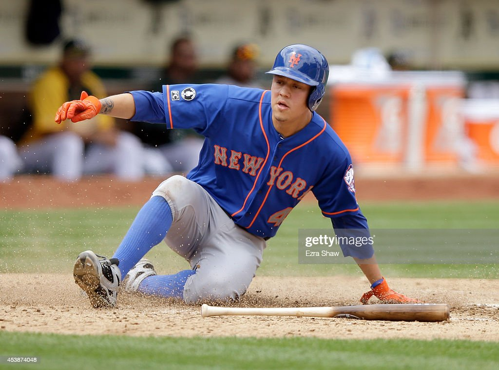 <a gi-track='captionPersonalityLinkClicked' href=/galleries/search?phrase=Wilmer+Flores&family=editorial&specificpeople=5970686 ng-click='$event.stopPropagation()'>Wilmer Flores</a> #4 of the New York Mets scores on a hit by Curtis Granderson #3 in the fourth inning of their game against the Oakland Athletics at O.co Coliseum on August 20, 2014 in Oakland, California.