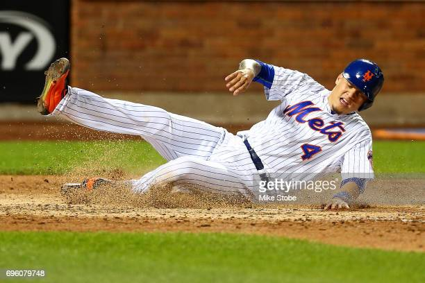 Wilmer Flores of the New York Mets scores on TJ Rivera RBI single in the eighth inning against the Chicago Cubs at Citi Field on June 14 2017 in the...