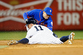 Wilmer Flores of the New York Mets tags out Brett Gardner of the New York Yankees trying to stretch a single into a double in the third inning on...
