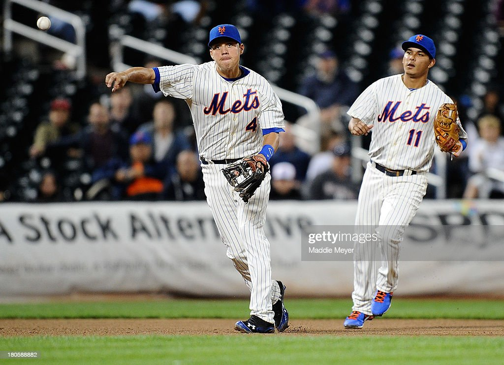 <a gi-track='captionPersonalityLinkClicked' href=/galleries/search?phrase=Wilmer+Flores&family=editorial&specificpeople=5970686 ng-click='$event.stopPropagation()'>Wilmer Flores</a> #4 of the New York Mets throws to first to tag out Justin Ruggiano #20 of the Miami Marlins as Ruben Tejada #11 of the Mets looks on during the sixth inning of game two of a doubleheader on September 14, 2013 at Citi Field in the Flushing neighborhood of the Queens borough of New York City.