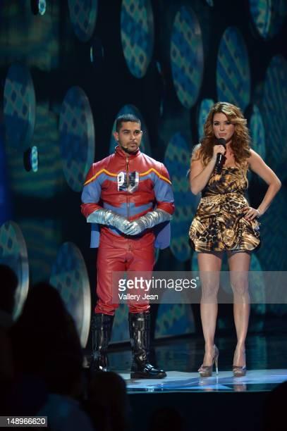 Wilmer Valderrama and Alicia Machado onstage during Univision's Premios Juventud Awards at Bank United Center on July 19 2012 in Miami Florida