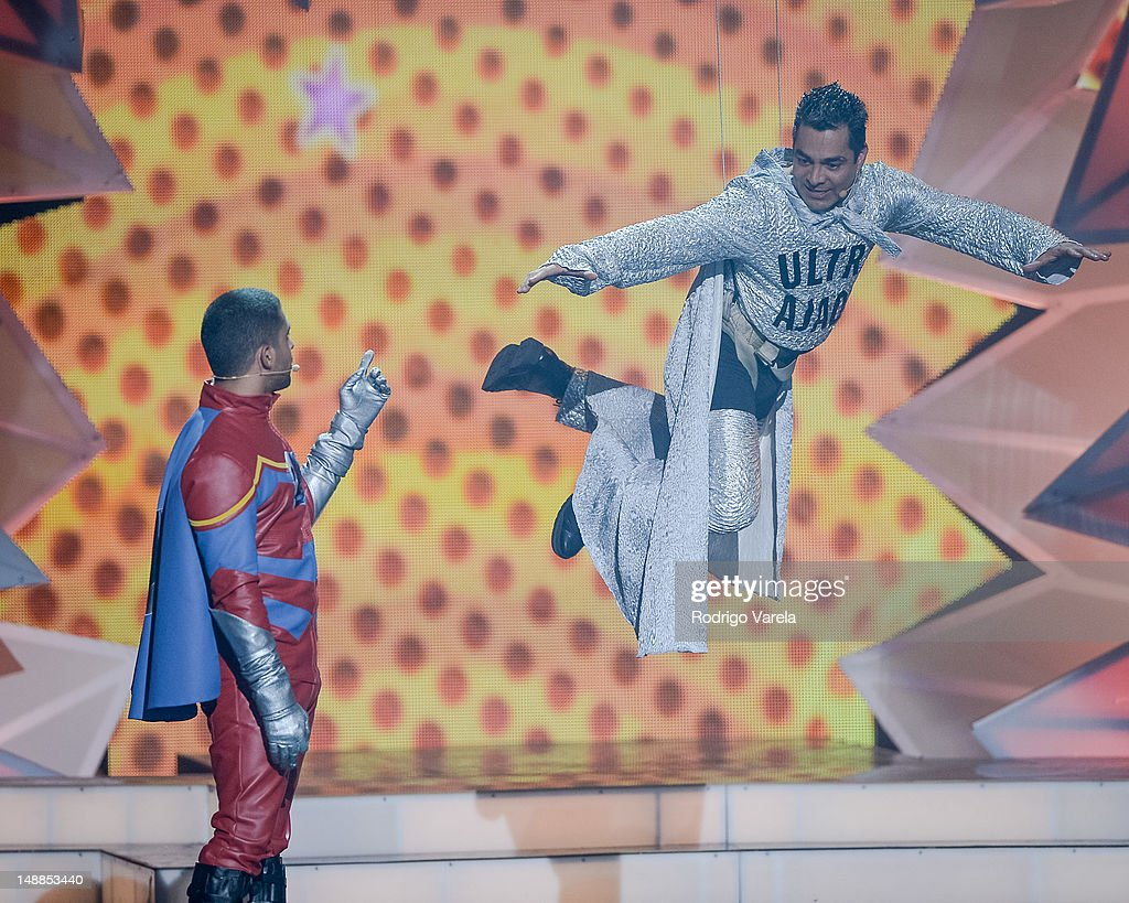 <a gi-track='captionPersonalityLinkClicked' href=/galleries/search?phrase=Wilmer+Valderrama&family=editorial&specificpeople=202028 ng-click='$event.stopPropagation()'>Wilmer Valderrama</a> and Omar onstage during the Univision's Premios Juventud Awards at Bank United Center on July 19, 2012 in Miami, Florida.