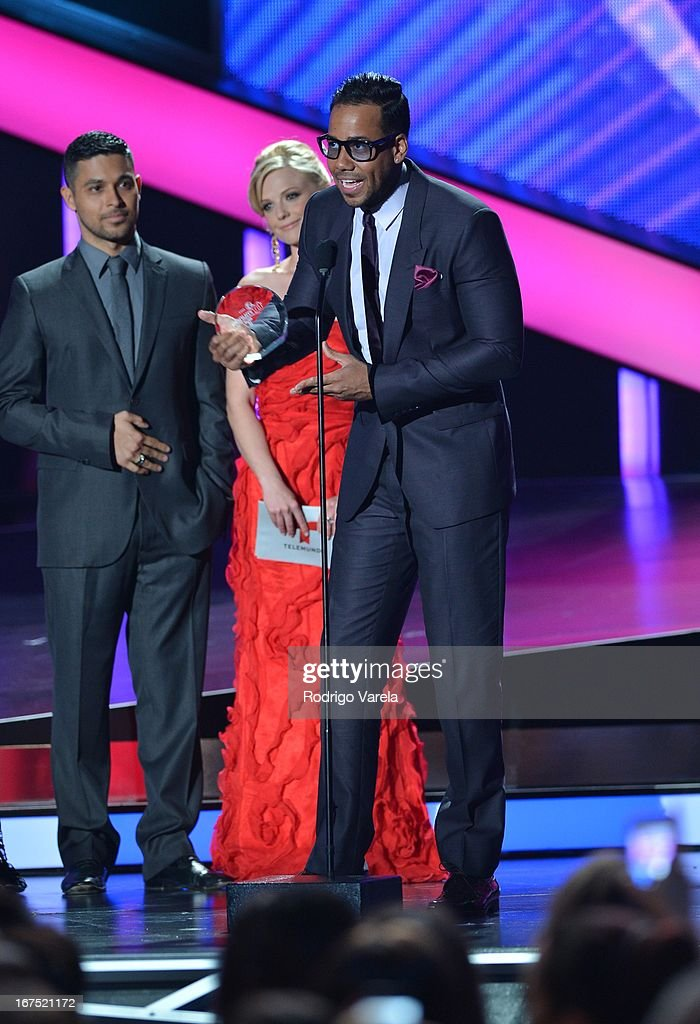 Wilmer Valderrama and Romeo Santos on stage at Billboard Latin Music Awards 2013 at Bank United Center on April 25, 2013 in Miami, Florida.