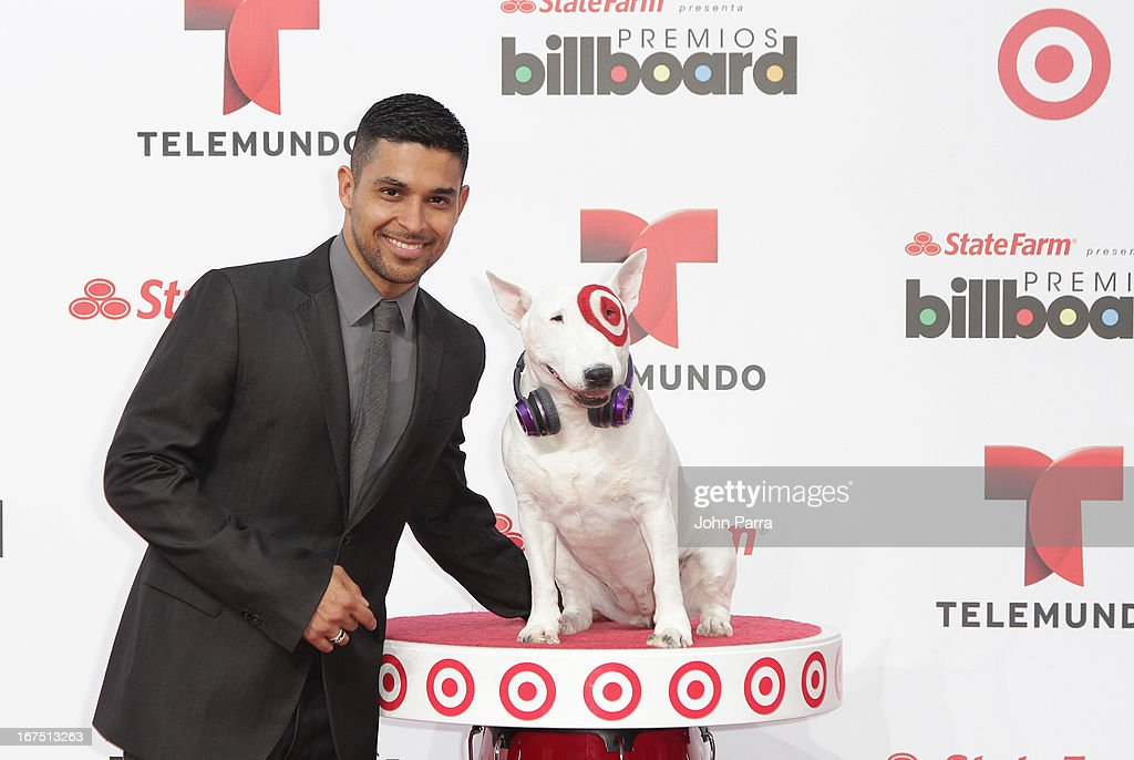 Wilmer Valderrama celebrates with Bullseye, Target's Beloved Bull Terrier Mascot, at the 2013 Billboard Latin Music Awards at BankUnited Center on April 25, 2013 in Miami, Florida.