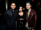Wilmer Valderrama Demi Lovato and Joe Jonas attend the Moet Chandon AMA After Party with Jennifer Lopez at HYDE Sunset Kitchen Cocktails on November...