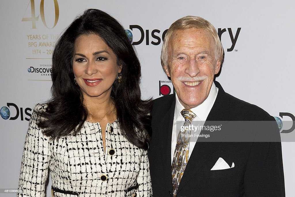 Wilnelia Forsyth and Sir <a gi-track='captionPersonalityLinkClicked' href=/galleries/search?phrase=Bruce+Forsyth&family=editorial&specificpeople=158119 ng-click='$event.stopPropagation()'>Bruce Forsyth</a> attend the Broadcasting Press Guild Awards sponsored by The Discovery Channel at Theatre Royal on March 28, 2014 in London, England.