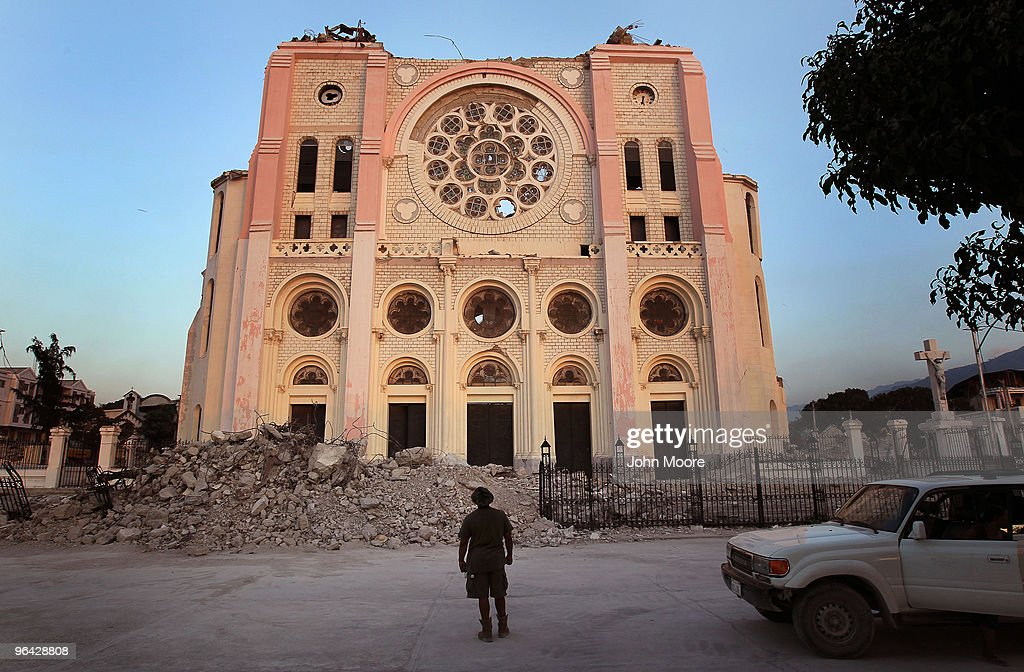 Wilner Dorce a US Army soldier and native Haitian looks at the remains of Haiti's national cathedral after he arrived on February 4 2010 to...