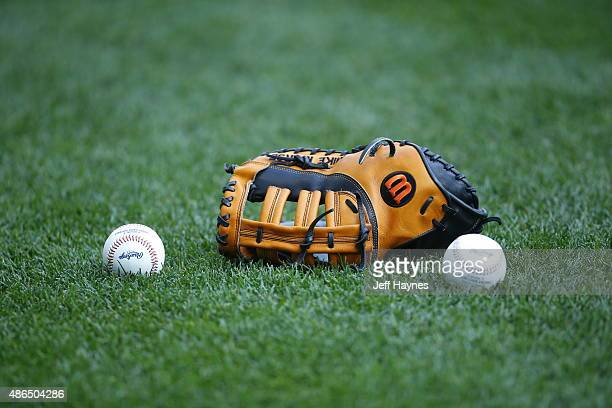 Wilson baseball glove and major league baseballs sits on the field at Miller Park on September 3 2015 in Milwaukee Wisconsin