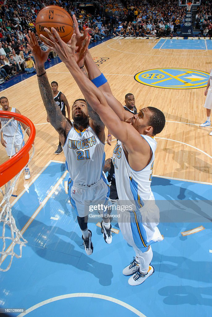 <a gi-track='captionPersonalityLinkClicked' href=/galleries/search?phrase=Wilson+Chandler&family=editorial&specificpeople=809324 ng-click='$event.stopPropagation()'>Wilson Chandler</a> #21 and <a gi-track='captionPersonalityLinkClicked' href=/galleries/search?phrase=JaVale+McGee&family=editorial&specificpeople=4195625 ng-click='$event.stopPropagation()'>JaVale McGee</a> #34 of the Denver Nuggets grabs the rebound against the Sacramento Kings on January 26, 2013 at the Pepsi Center in Denver, Colorado.