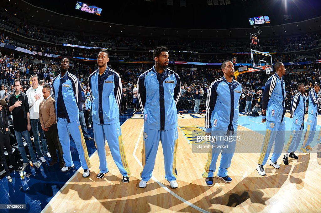 <a gi-track='captionPersonalityLinkClicked' href=/galleries/search?phrase=Wilson+Chandler&family=editorial&specificpeople=809324 ng-click='$event.stopPropagation()'>Wilson Chandler</a> #21 and the Denver Nuggets stand on the court before the game against the Los Angeles Lakers on November 13, 2013 at the Pepsi Center in Denver, Colorado.