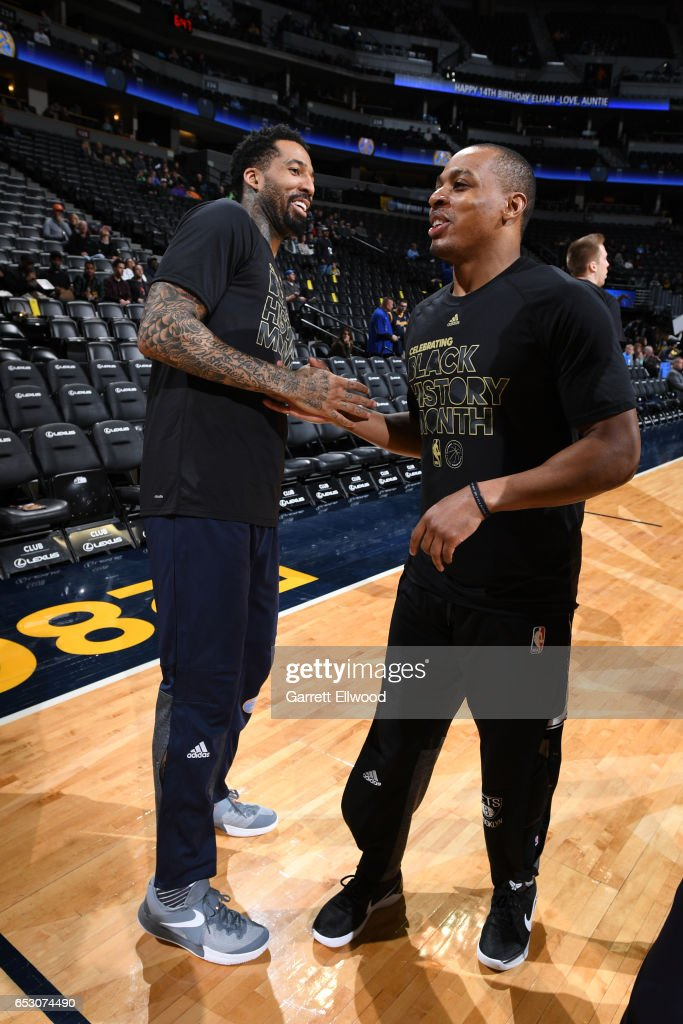 Wilson Chandler #21 of the Denver Nuggets and Randy Foye #2 of the Brooklyn Nets talk before the game on February 24, 2017 at the Pepsi Center in Denver, Colorado.