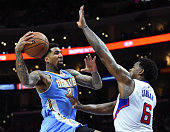 Wilson Chandler of the Denver Nuggets attempts a layup in front of DeAndre Jordan of the Los Angeles Clippers during the first half at Staples Center...