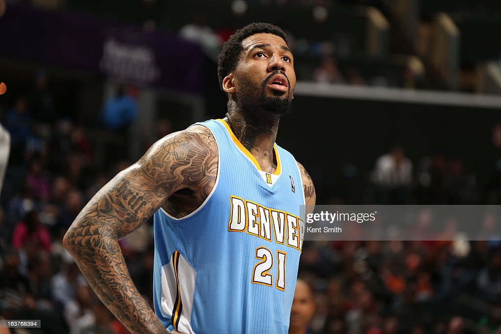Wilson Chandler #21 of the Denver Nuggets awaits the result of a foul shot against the Charlotte Bobcats at the Time Warner Cable Arena on February 23, 2013 in Charlotte, North Carolina.