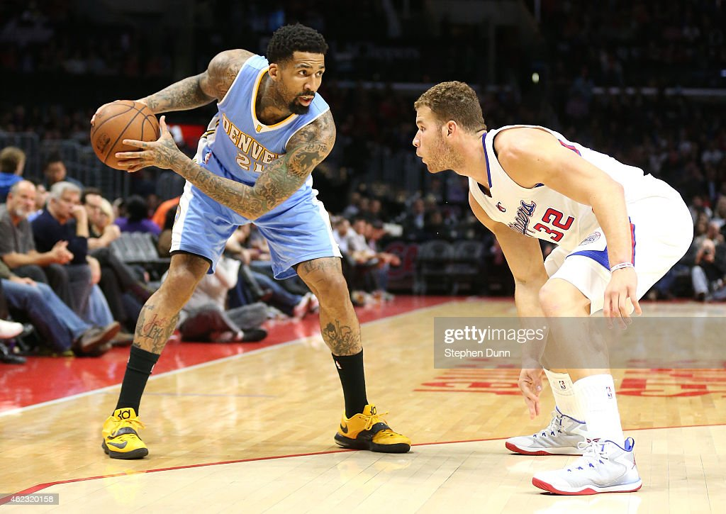 Wilson Chandler of the Denver Nuggets controls the ball against Blake Griffin of the Los Angeles Clippers at Staples Center on January 26 2015 in Los...