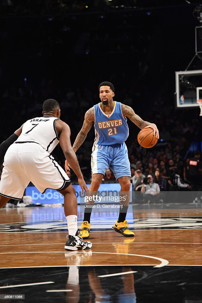 Wilson Chandler of the Denver Nuggets controls the ball against the Brooklyn Nets on December 23 2014 at the Barclays Center in Brooklyn NY NOTE TO...