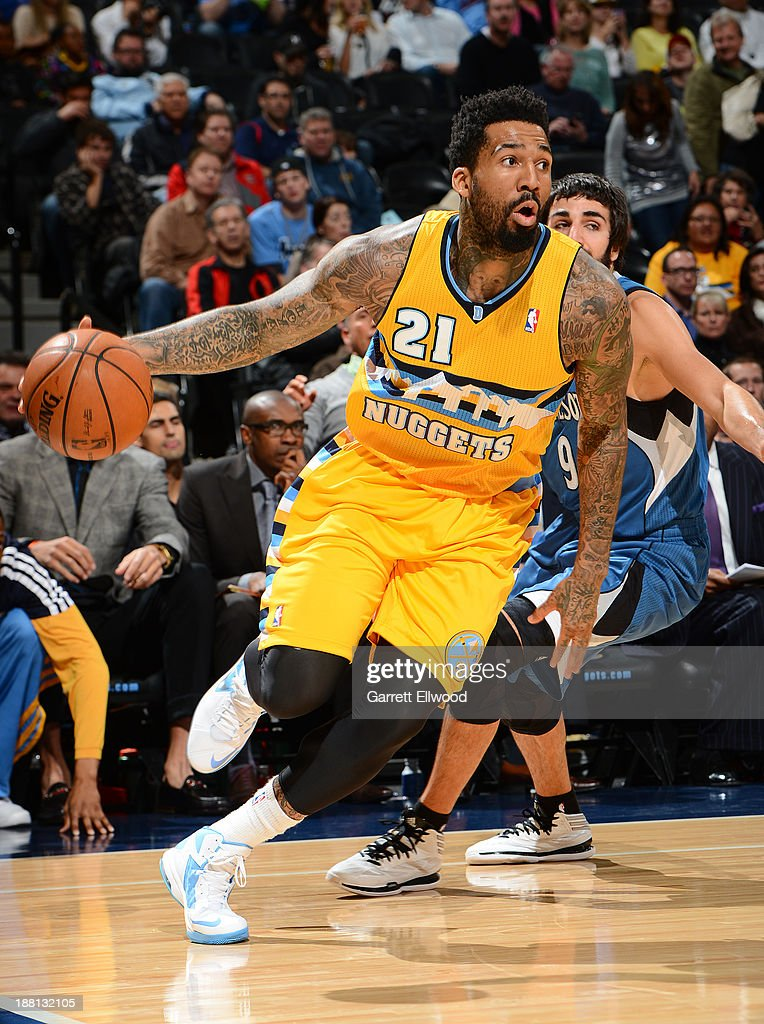 Wilson Chandler #21 of the Denver Nuggets dribbles to the basket against the Minnesota Timberwolves on November 15, 2013 at the Pepsi Center in Denver, Colorado.