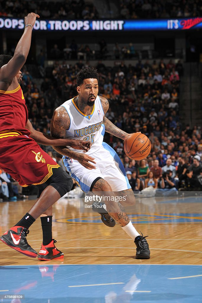 <a gi-track='captionPersonalityLinkClicked' href=/galleries/search?phrase=Wilson+Chandler&family=editorial&specificpeople=809324 ng-click='$event.stopPropagation()'>Wilson Chandler</a> #21 of the Denver Nuggets drives against the Cleveland Cavaliers on January 17, 2014 at the Pepsi Center in Denver, Colorado.