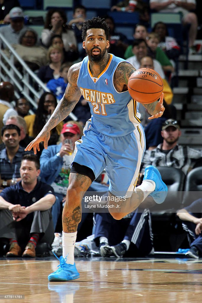 Wilson Chandler of the Denver Nuggets drives against the New Orleans Pelicans on March 10 2014 at the Smoothie King Center in New Orleans Louisiana...