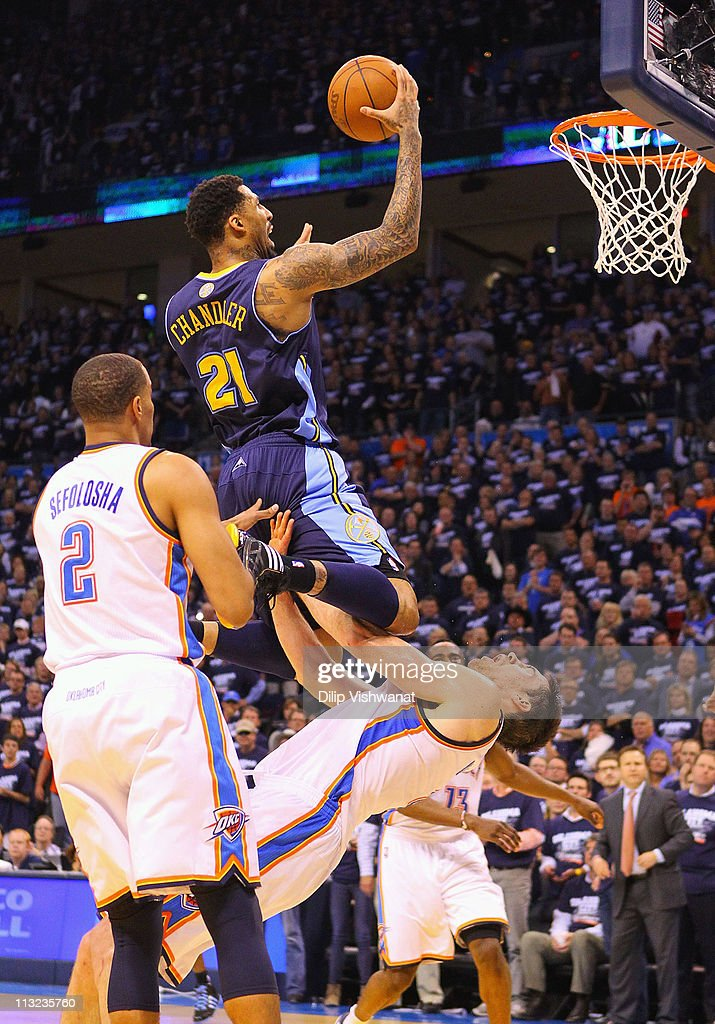 <a gi-track='captionPersonalityLinkClicked' href=/galleries/search?phrase=Wilson+Chandler&family=editorial&specificpeople=809324 ng-click='$event.stopPropagation()'>Wilson Chandler</a> #21 of the Denver Nuggets drives to the basket against <a gi-track='captionPersonalityLinkClicked' href=/galleries/search?phrase=Nick+Collison&family=editorial&specificpeople=202843 ng-click='$event.stopPropagation()'>Nick Collison</a> #4 of the Oklahoma City Thunder in Game Five of the Western Conference Quarterfinals in the 2011 NBA Playoffs on April 27, 2011 at the Ford Center in Oklahoma City, Oklahoma.