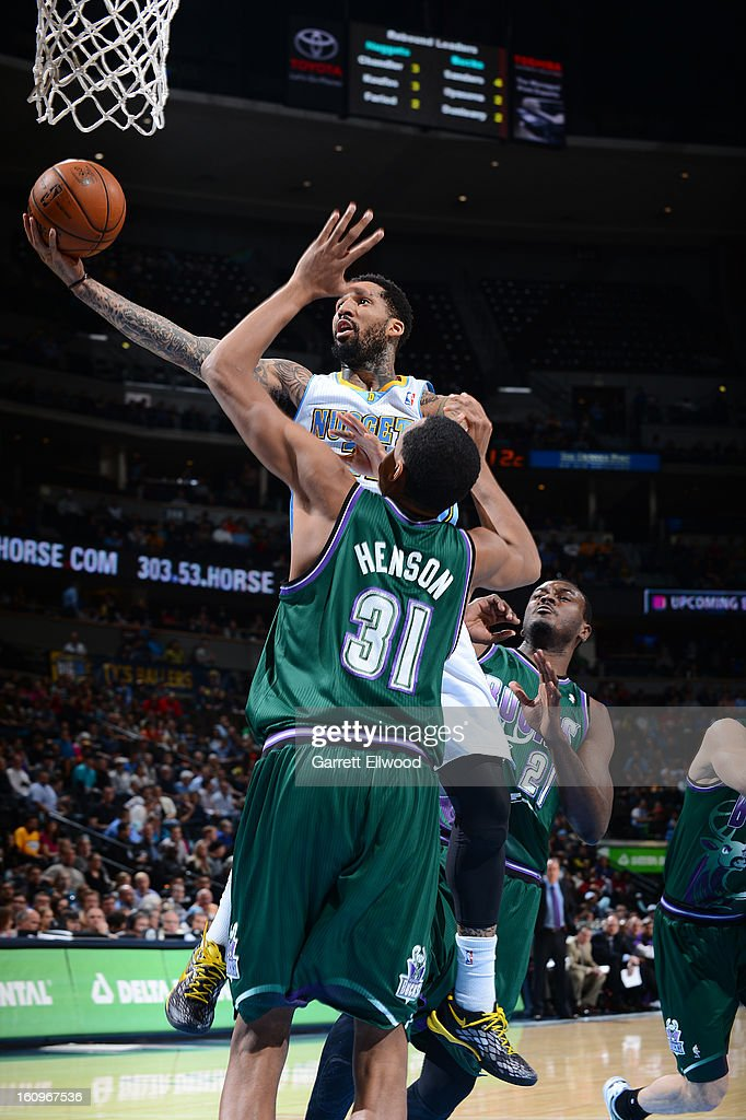 Wilson Chandler #21 of the Denver Nuggets drives to the basket against John Henson #31 of the Milwaukee Bucks on February 5, 2013 at the Pepsi Center in Denver, Colorado.