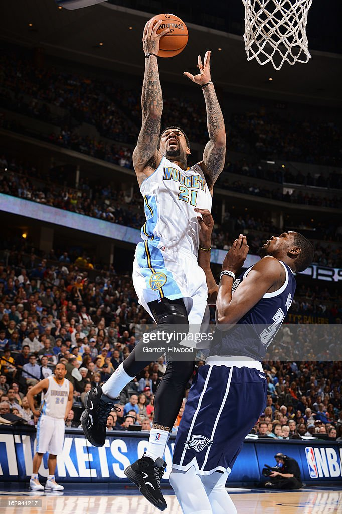 Wilson Chandler #21 of the Denver Nuggets drives to the basket against Kevin Durant #35 of the Oklahoma City Thunder on March 1, 2013 at the Pepsi Center in Denver, Colorado.
