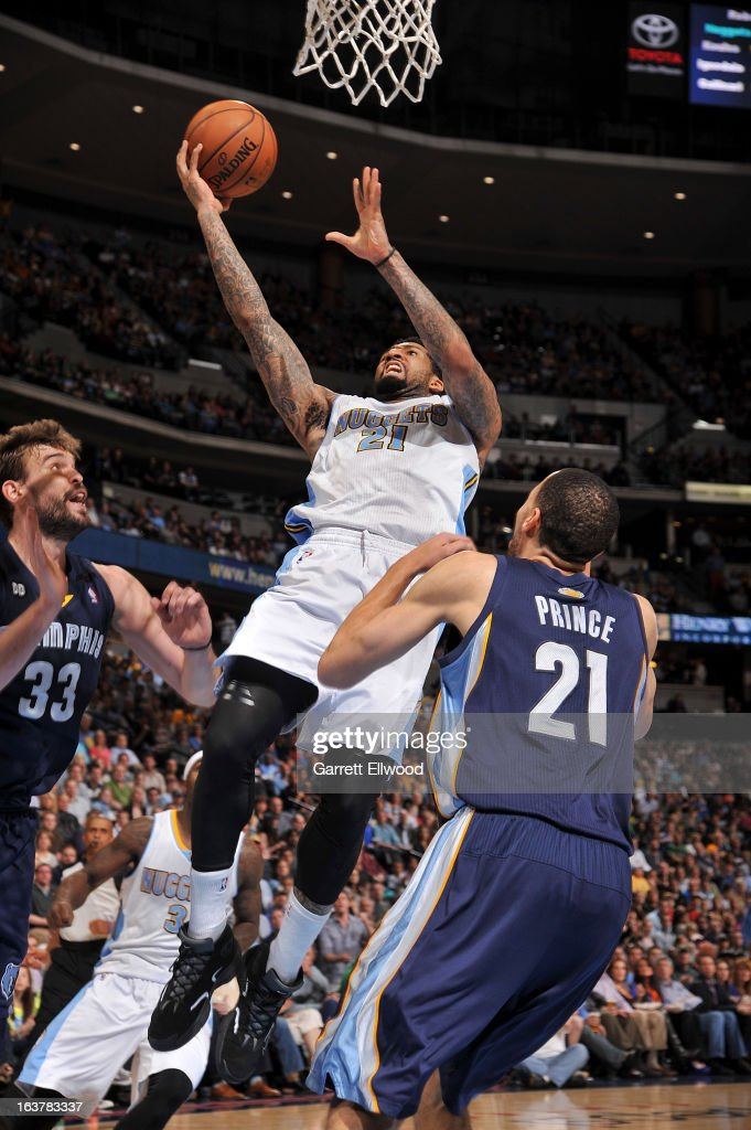<a gi-track='captionPersonalityLinkClicked' href=/galleries/search?phrase=Wilson+Chandler&family=editorial&specificpeople=809324 ng-click='$event.stopPropagation()'>Wilson Chandler</a> #21 of the Denver Nuggets drives to the basket against <a gi-track='captionPersonalityLinkClicked' href=/galleries/search?phrase=Marc+Gasol&family=editorial&specificpeople=661205 ng-click='$event.stopPropagation()'>Marc Gasol</a> #33 and <a gi-track='captionPersonalityLinkClicked' href=/galleries/search?phrase=Tayshaun+Prince&family=editorial&specificpeople=201553 ng-click='$event.stopPropagation()'>Tayshaun Prince</a> #21 of the Memphis Grizzlies on March 15, 2013 at the Pepsi Center in Denver, Colorado.