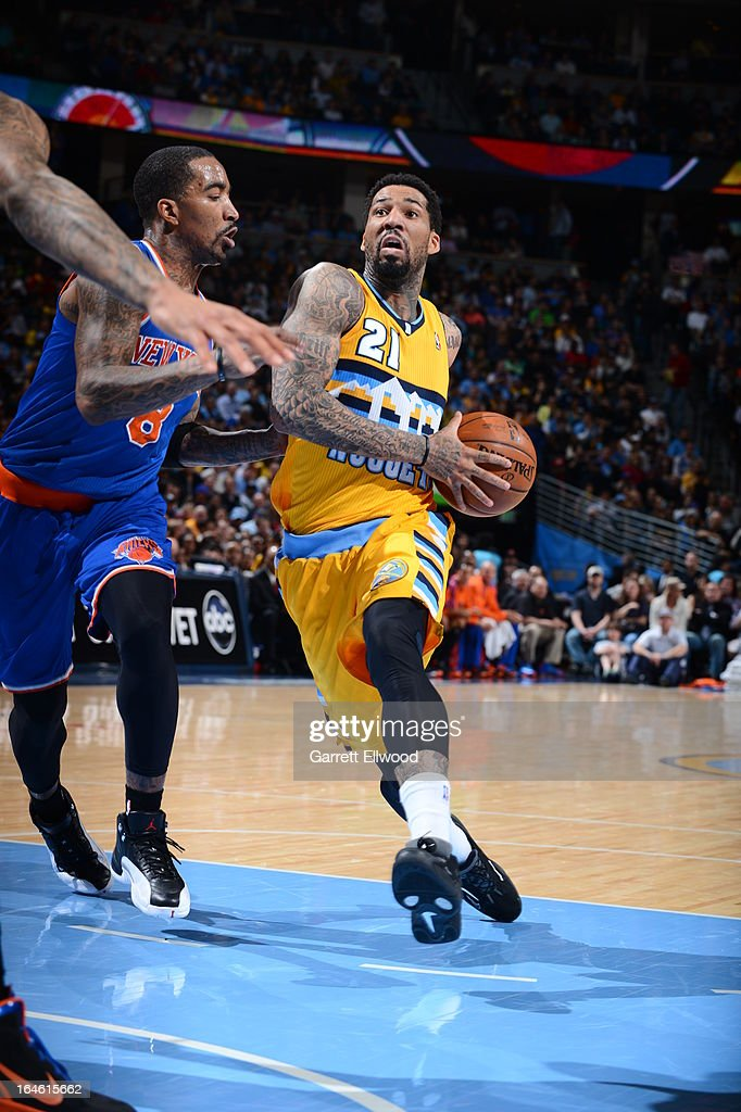 Wilson Chandler #21 of the Denver Nuggets drives to the basket against the New York Knicks on March 13, 2013 at the Pepsi Center in Denver, Colorado.