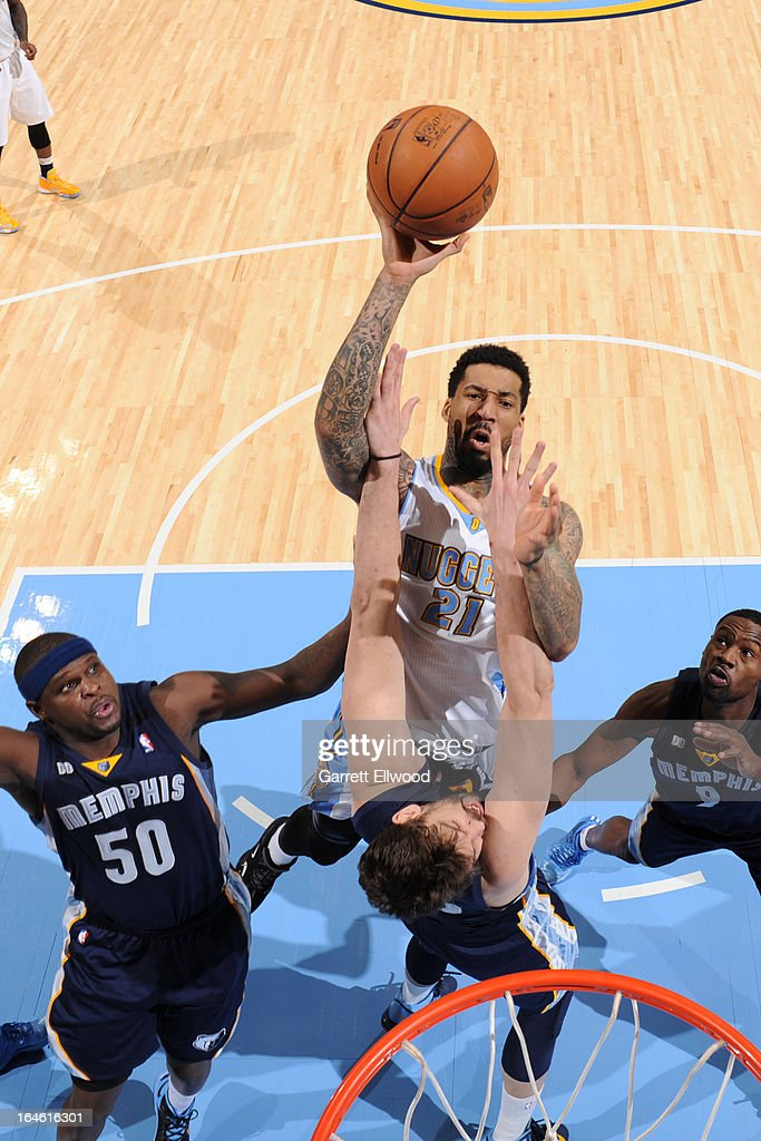 <a gi-track='captionPersonalityLinkClicked' href=/galleries/search?phrase=Wilson+Chandler&family=editorial&specificpeople=809324 ng-click='$event.stopPropagation()'>Wilson Chandler</a> #21 of the Denver Nuggets drives to the basket against the Memphis Grizzlies on March 15, 2013 at the Pepsi Center in Denver, Colorado.