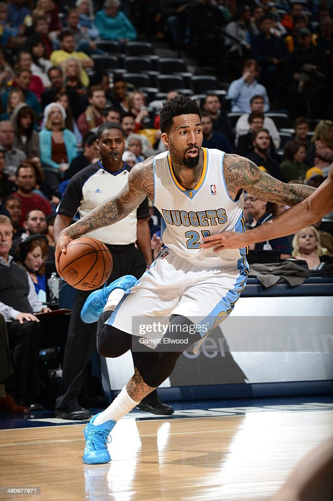 <a gi-track='captionPersonalityLinkClicked' href=/galleries/search?phrase=Wilson+Chandler&family=editorial&specificpeople=809324 ng-click='$event.stopPropagation()'>Wilson Chandler</a> #21 of the Denver Nuggets drives to the basket against the Utah Jazz on December 13, 2013 at the Pepsi Center in Denver, Colorado.