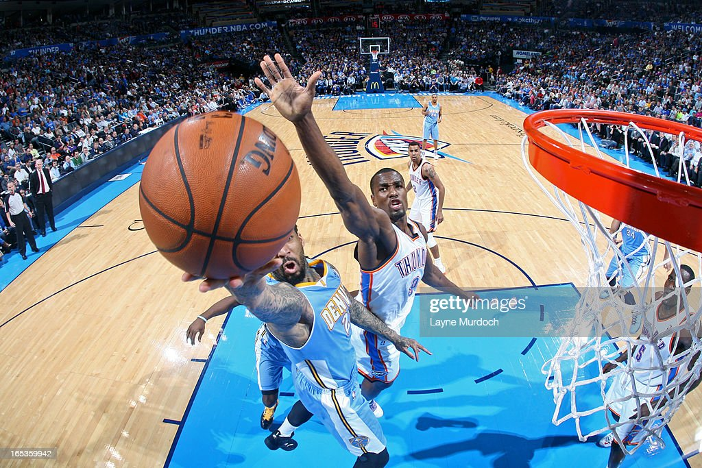 Wilson Chandler #21 of the Denver Nuggets drives to the basket around Serge Ibaka #9 of the Oklahoma City Thunder on March 19, 2013 at the Chesapeake Energy Arena in Oklahoma City, Oklahoma.