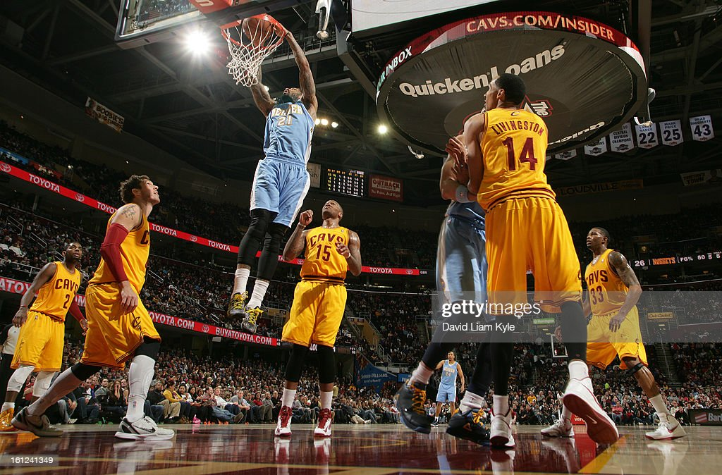 Wilson Chandler #21 of the Denver Nuggets dunks the ball against Luke Walton #4, Marreese Speights #15 and Shaun Livingston #14 of the Cleveland Cavaliers at The Quicken Loans Arena on February 9, 2013 in Cleveland, Ohio.