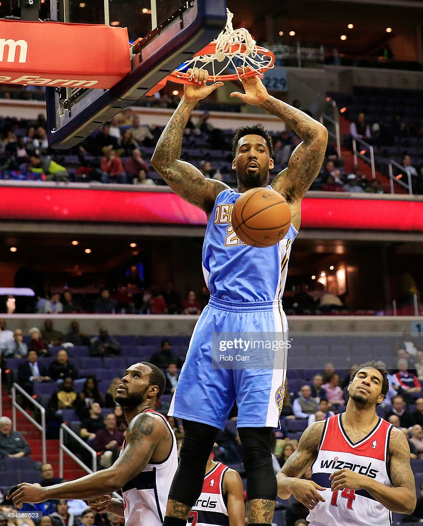 <a gi-track='captionPersonalityLinkClicked' href=/galleries/search?phrase=Wilson+Chandler&family=editorial&specificpeople=809324 ng-click='$event.stopPropagation()'>Wilson Chandler</a> #21 of the Denver Nuggets dunks the ball against the Washington Wizards in the fourth quarter during the Nuggets 75-74 win at Verizon Center on December 9, 2013 in Washington, DC.