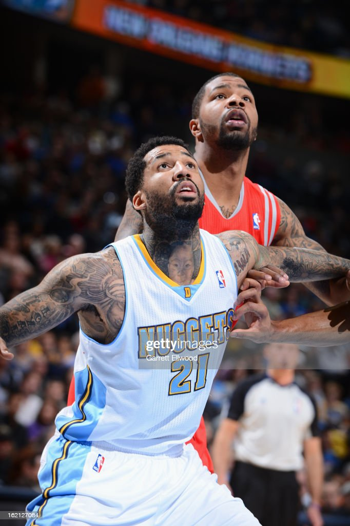 Wilson Chandler #21 of the Denver Nuggets fights for the rebound against Marcus Morris #2 of the Houston Rockets on January 30, 2013 at the Pepsi Center in Denver, Colorado.