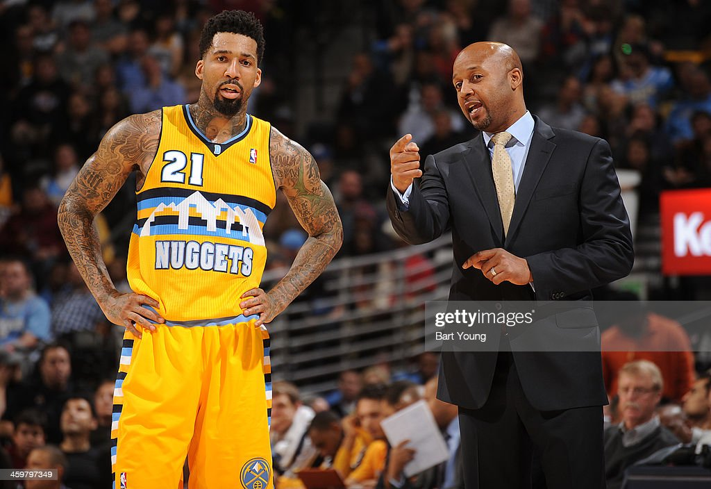 Wilson Chandler of the Denver Nuggets gets direction from his coach against the Miami Heat on December 30 2013 at the Pepsi Center in Denver Colorado...