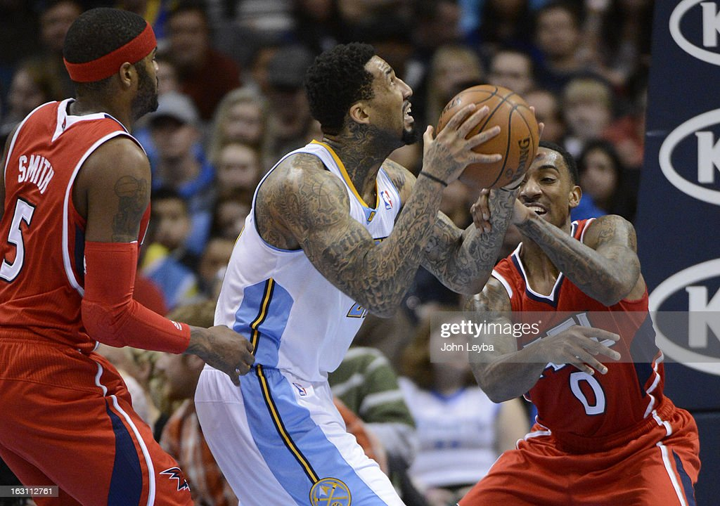 Wilson Chandler (21) of the Denver Nuggets gets hit on the wrist by Jeff Teague (0) of the Atlanta Hawks during the third quarter March 4, 2013 at Pepsi Center. The Denver Nuggets defeated the Atlanta Hawks 104-88.