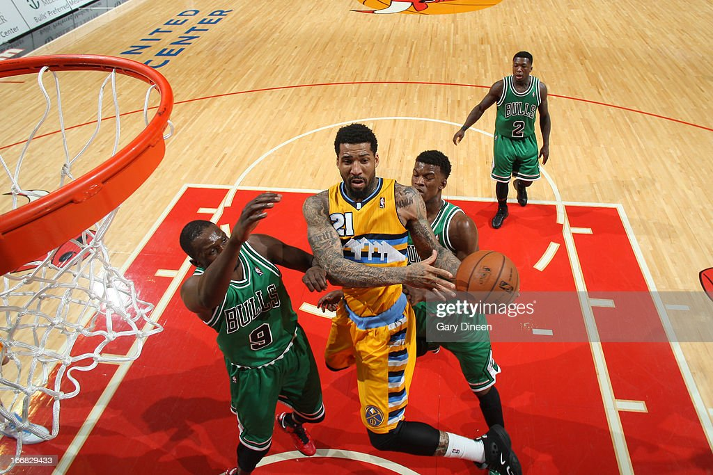 <a gi-track='captionPersonalityLinkClicked' href=/galleries/search?phrase=Wilson+Chandler&family=editorial&specificpeople=809324 ng-click='$event.stopPropagation()'>Wilson Chandler</a> #21 of the Denver Nuggets goes to the basket against <a gi-track='captionPersonalityLinkClicked' href=/galleries/search?phrase=Luol+Deng&family=editorial&specificpeople=202830 ng-click='$event.stopPropagation()'>Luol Deng</a> #9 and <a gi-track='captionPersonalityLinkClicked' href=/galleries/search?phrase=Jimmy+Butler+-+Basketball+Player&family=editorial&specificpeople=9860567 ng-click='$event.stopPropagation()'>Jimmy Butler</a> #21 of the Chicago Bulls on March 18, 2013 at the United Center in Chicago, Illinois.