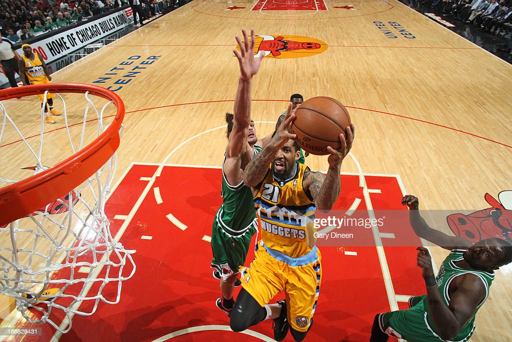 <a gi-track='captionPersonalityLinkClicked' href=/galleries/search?phrase=Wilson+Chandler&family=editorial&specificpeople=809324 ng-click='$event.stopPropagation()'>Wilson Chandler</a> #21 of the Denver Nuggets goes to the basket against <a gi-track='captionPersonalityLinkClicked' href=/galleries/search?phrase=Joakim+Noah&family=editorial&specificpeople=699038 ng-click='$event.stopPropagation()'>Joakim Noah</a> #13 of the Chicago Bulls on March 18, 2013 at the United Center in Chicago, Illinois.