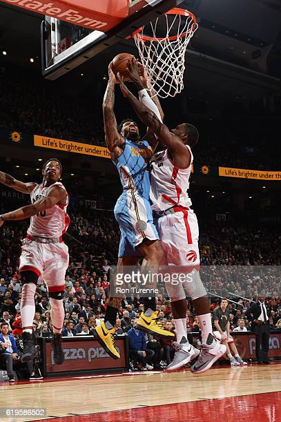 Wilson Chandler of the Denver Nuggets goes up for a dunk against Patrick Patterson of the Toronto Raptors during a game on October 31 2016 at the Air...