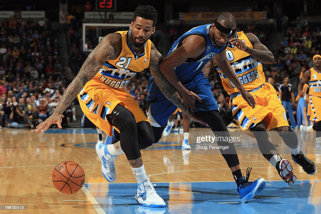 Wilson Chandler #21 of the Denver Nuggets grabs a loose ball away from Corey Brewer #13 of the Minnesota Timberwolves at Pepsi Center on November 15, 2013 in Denver, Colorado.