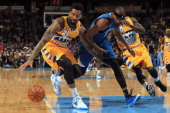 Wilson Chandler of the Denver Nuggets grabs a loose ball away from Corey Brewer of the Minnesota Timberwolves at Pepsi Center on November 15 2013 in...