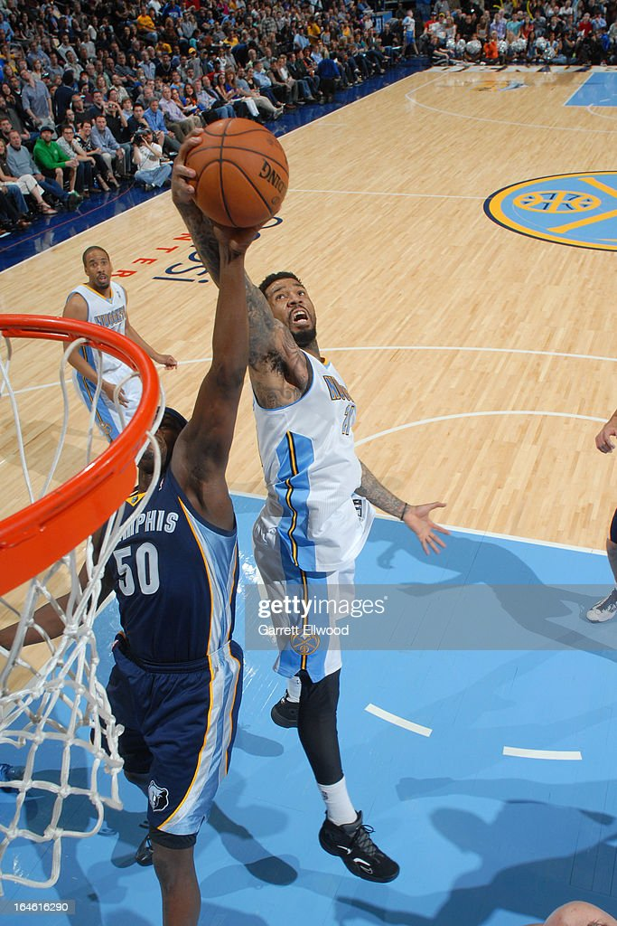 <a gi-track='captionPersonalityLinkClicked' href=/galleries/search?phrase=Wilson+Chandler&family=editorial&specificpeople=809324 ng-click='$event.stopPropagation()'>Wilson Chandler</a> #21 of the Denver Nuggets grabs a rebound against the Memphis Grizzlies on March 15, 2013 at the Pepsi Center in Denver, Colorado.