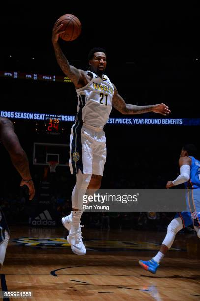 Wilson Chandler of the Denver Nuggets grabs the rebound against the Oklahoma City Thunder on October 10 2017 at the Pepsi Center in Denver Colorado...