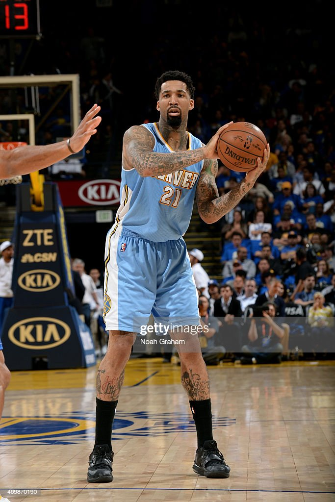 Wilson Chandler of the Denver Nuggets handles the ball against the Golden State Warriors on April 15 2015 at Oracle Arena in Oakland California NOTE...