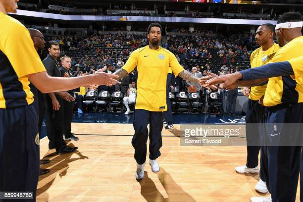 Wilson Chandler of the Denver Nuggets high fives his teammates before the game against the Oklahoma City Thunder on October 10 2017 at the Pepsi...