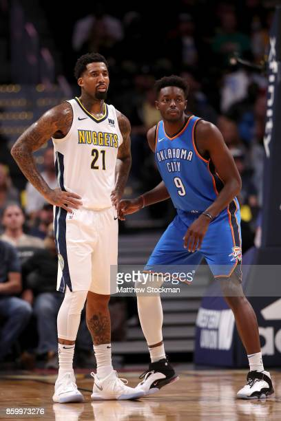 Wilson Chandler of the Denver Nuggets is guarded by Jerami Grant of the Oklahoma City Thunder at the Pepsi Center on October 10 2017 in Denver...