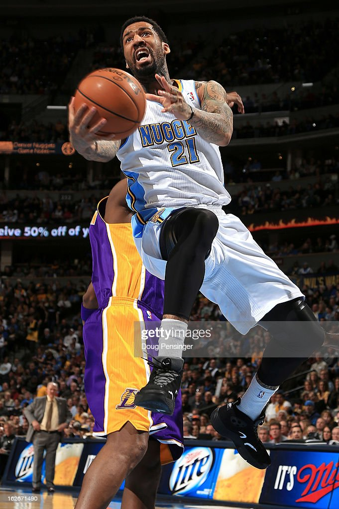 Wilson Chandler #21 of the Denver Nuggets lays up a shot against the Los Angeles Lakers at the Pepsi Center on February 25, 2013 in Denver, Colorado.