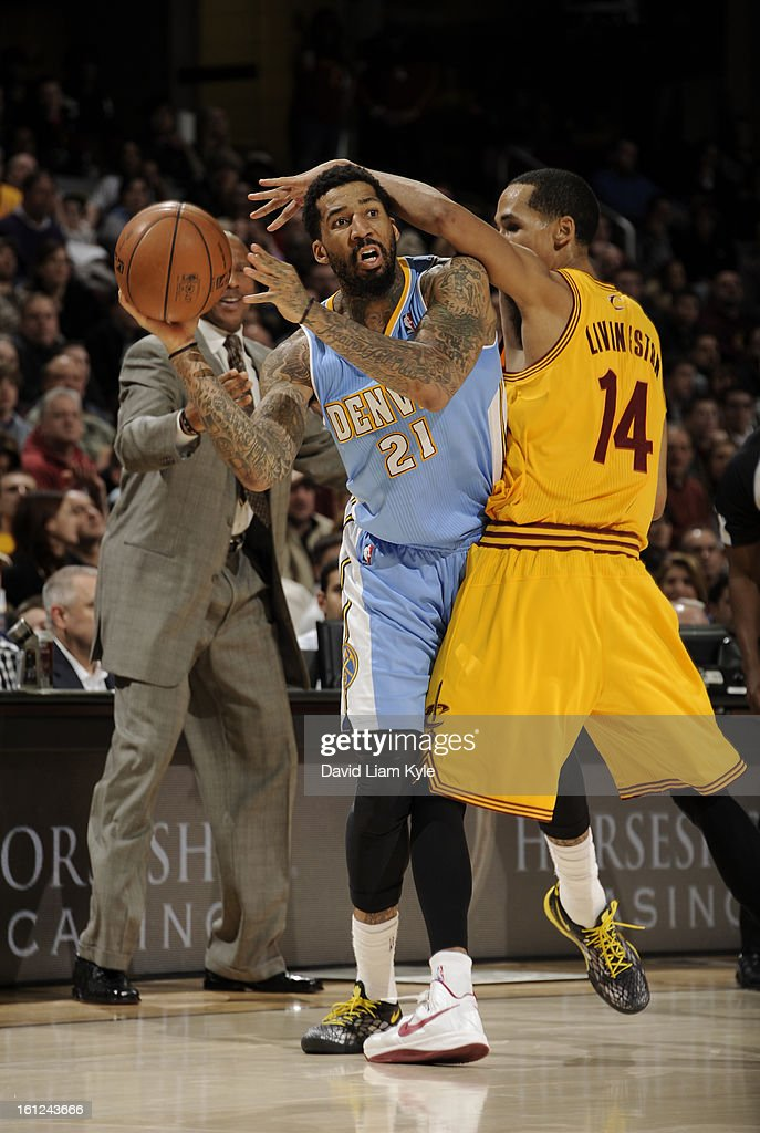 Wilson Chandler #21 of the Denver Nuggets looks to pass the ball under pressure by Shaun Livingston #14 of the Cleveland Cavaliers at The Quicken Loans Arena on February 9, 2013 in Cleveland, Ohio.