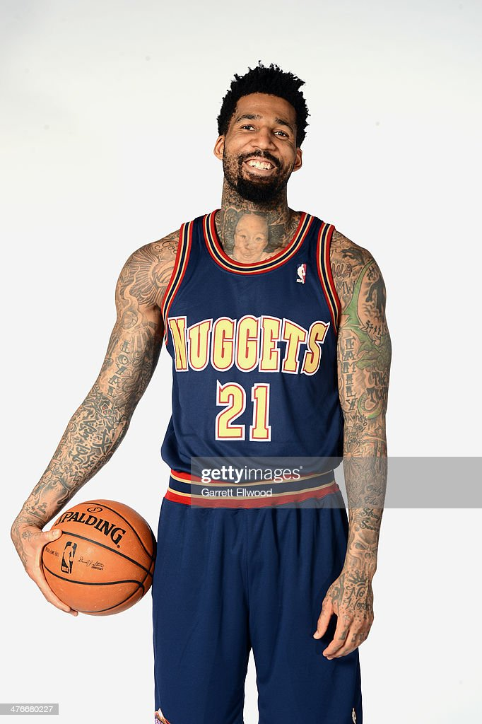 Wilson Chandler of the Denver Nuggets poses for photos wearing the uniform from the 19931994 season on March 4 2014 at the Pepsi Center in Denver...
